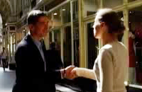 Screenshot from video of two people greeting each other.