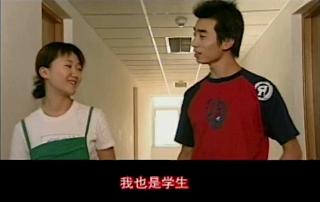 two people walk through a hallway talking
